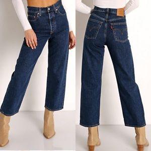 Levi's 501 jeans across a plain cropped raw hem 26